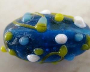 capribluelampworkglassbead18x14mm